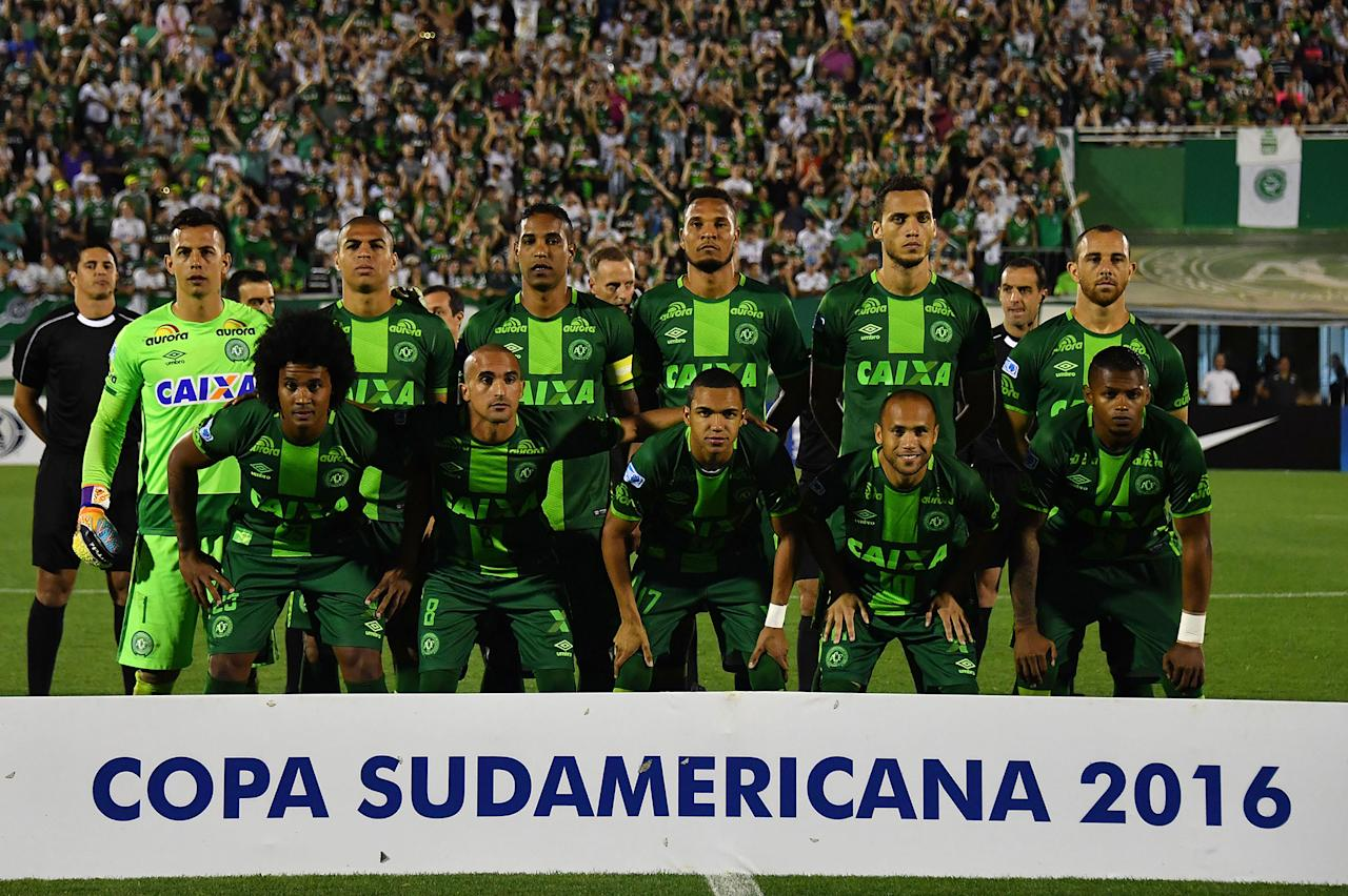 <p>Brazil's Chapecoense players pose for pictures during their 2016 Copa Sudamericana semifinal second leg football match against Argentina's San Lorenzo held at Arena Conda stadium, in Chapeco, Brazil, on Nov. 23, 2016. (Nelson Almeida/AFP/Getty Images) </p>