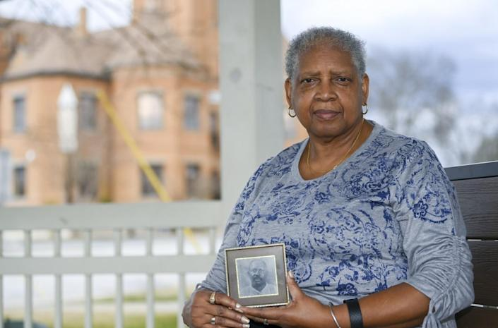Janie Holmes holds a photo of her great-grandfather Alex Ware