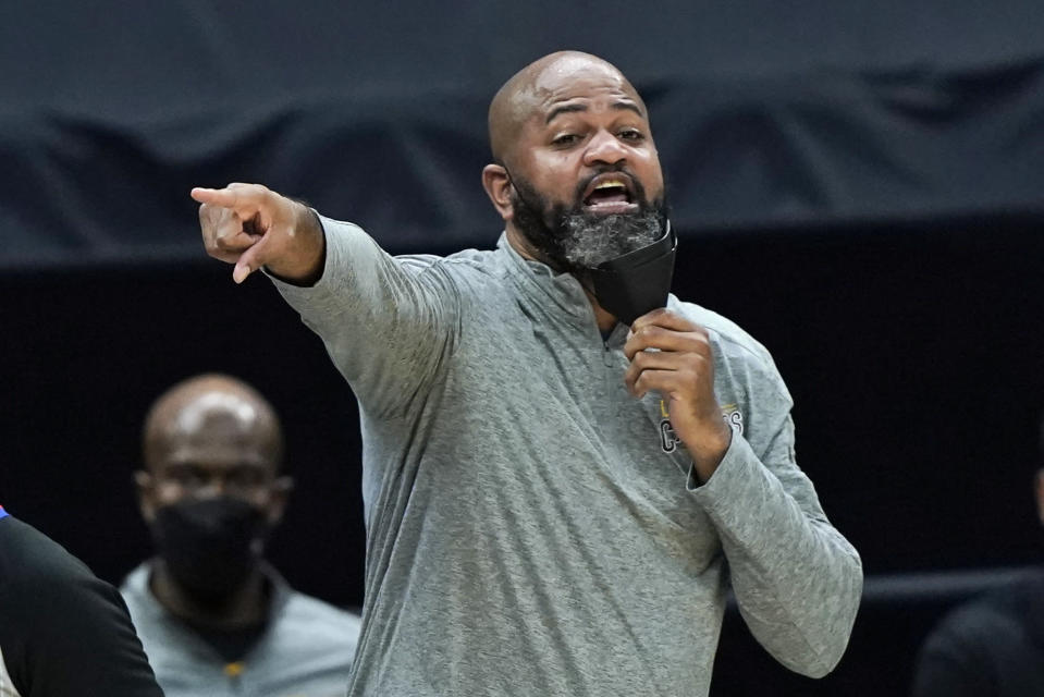 Cleveland Cavaliers head coach J.B. Bickerstaff yells instructions to players in the second half of an NBA basketball game against the Phoenix Suns, Tuesday, May 4, 2021, in Cleveland. Phoenix won 134-118 in overtime. (AP Photo/Tony Dejak)