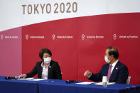 Seiko Hashimoto, left, president of the Tokyo 2020 Organizing Committee of the Olympic and Paralympic Games (Tokyo 2020), left, speaks during a news conference with Toshiro Muto, CEO of Tokyo 2020, attend a news conference Thursday, March 11, 2021, following the International Olympic Committee (IOC) general meeting. (AP Photo/Eugene Hoshiko, Pool)