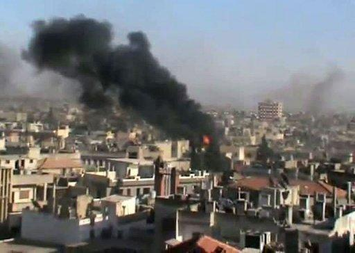 A YouTube image grab shows smoke billowing from the flashpoint Syrian city of Homs