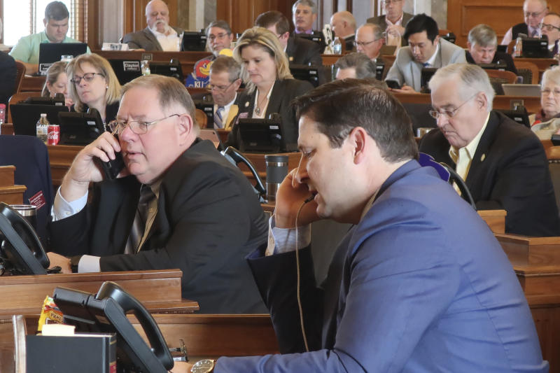 """Kansas House Majority Leader Dan Hawkins, center left, R-Wichita, and House Speaker Ron Ryckman Jr., center right, R-Olathe, work the phones during a House vote on a proposed amendment to the state constitution on abortion, Friday, Feb. 7, 2020, at the Statehouse in Topeka, Kansas. Hawkins and Ryckman were trying to round up the final votes needed to pass the proposed amendment, which overturns a Kansas Supreme Court decision declaring access to abortion a """"fundamental"""" right under the state's Bill of Rights. (AP Photo/John Hanna)"""