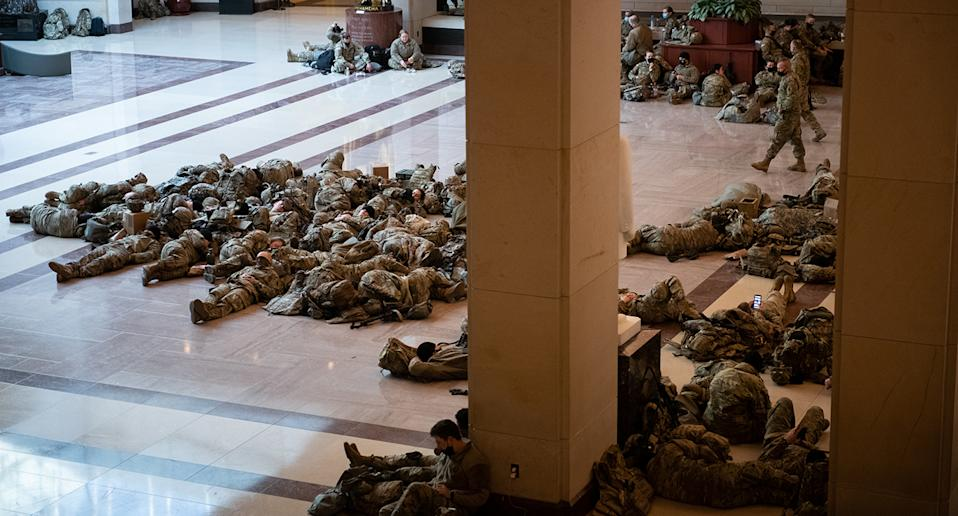Troops lie on a marble floor. Source: AP