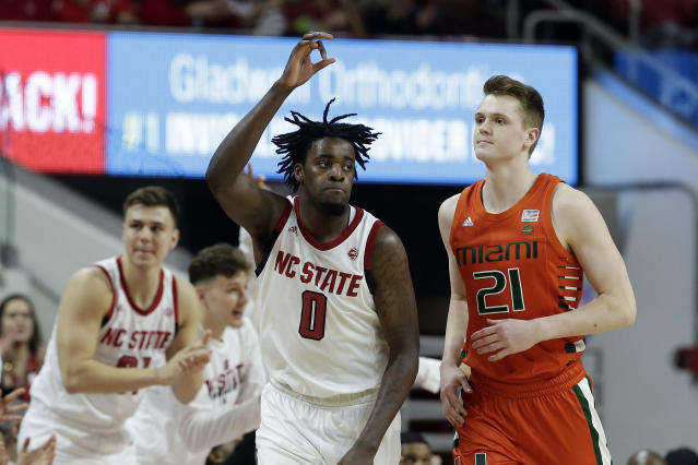North Carolina State forward D.J. Funderburk (0) reacts following a basket while Miami forward Sam Waardenburg (21) looks on during the second half of an NCAA college basketball game in Raleigh, N.C., Wednesday, Jan. 15, 2020. (AP Photo/Gerry Broome)