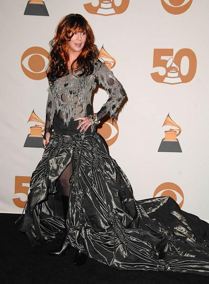 We couldn't be more excited for Cher's upcoming Las Vegas extravaganza, but this hideous gown that she donned at the Grammys has got to go. We pray that it's not a Bob Mackie design!