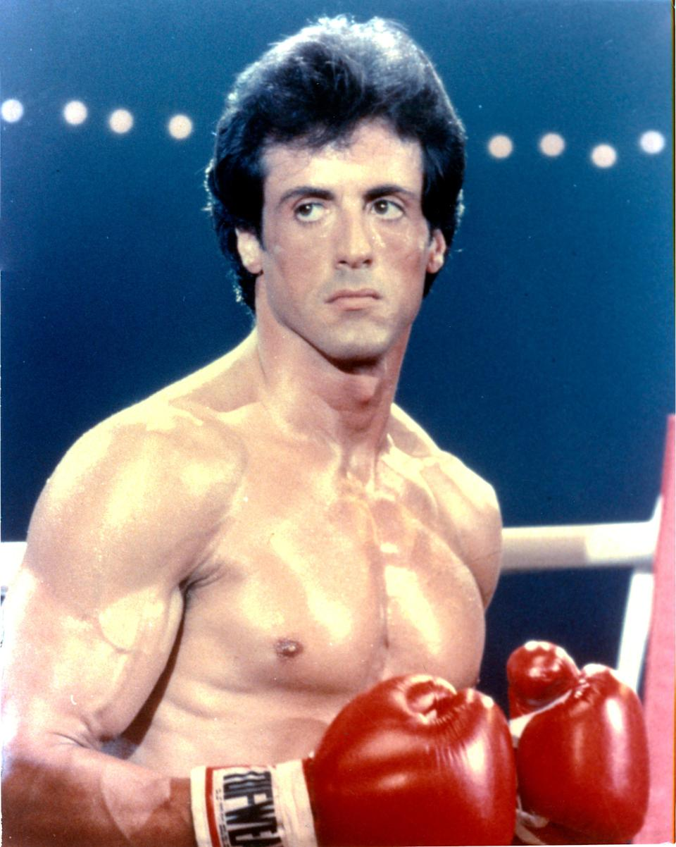 "<p>The ultimate underdog with the biggest heart, Rocky Balboa won over the masses when the film premiered in 1976. Written by and starring Sylvester Stallone, it won the Oscar for Best Picture the following year and cemented Rocky as the ultimate hero. His humor, compassion, and his love for Adrian (Talia Shire) captivated audiences and led to five additional films, plus the spin-off <em>Creed</em>. — <em>JR</em></p> <p><a href=""https://www.amazon.com/gp/video/detail/amzn1.dv.gti.90a9f791-628c-45b2-932a-834d837d7694?autoplay=1"" rel=""nofollow noopener"" target=""_blank"" data-ylk=""slk:Stream here"" class=""link rapid-noclick-resp""><em>Stream here</em></a></p>"