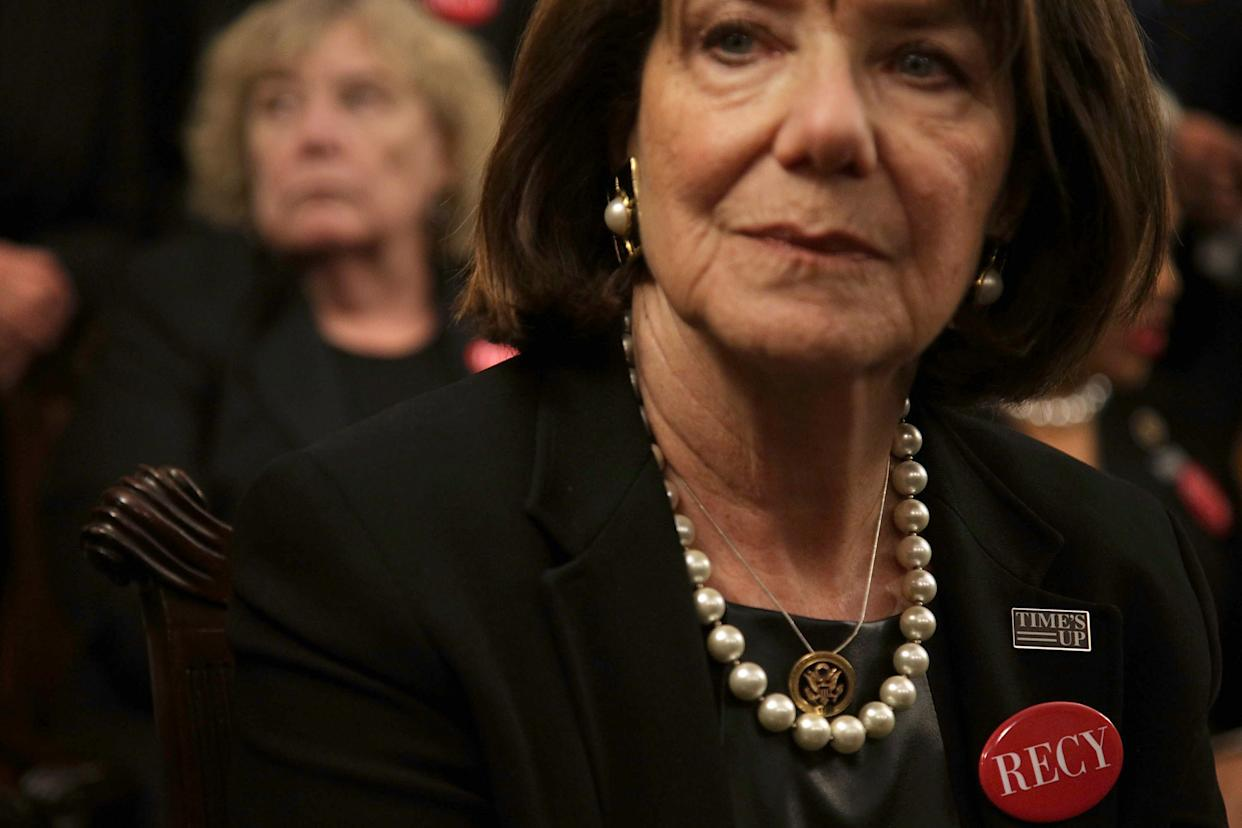 """Rep. Susan Davis (D-Calif.) wears black with a """"Time's Up"""" pin and a """"RECY"""" button."""