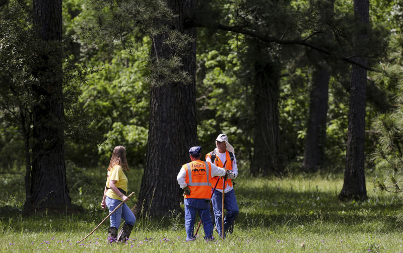 Members of Texas EquuSearch conduct a search for four-year-old Maleah Davis Monday, May 6, 2019, in Humble, Texas. Houston police are trying to determine what happened to the 4-year-old girl after her stepfather said she was taken by men who released him and his 2-year-old son after abducting them as well. (Godofredo A. Vásquez/Houston Chronicle via AP)