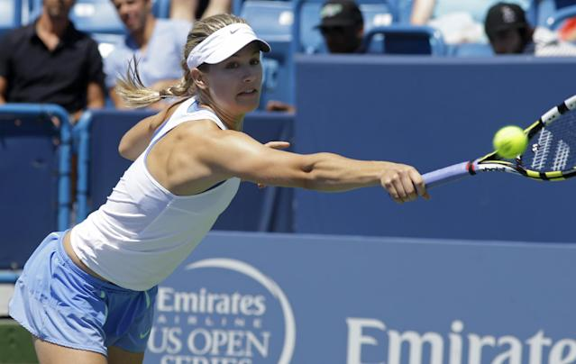 Eugenie Bouchard, from Canada, returns a serve against Serena Williams during a match at the Western & Southern Open tennis tournament, Wednesday, Aug. 14, 2013, in Mason, Ohio. (AP Photo/Al Behrman)