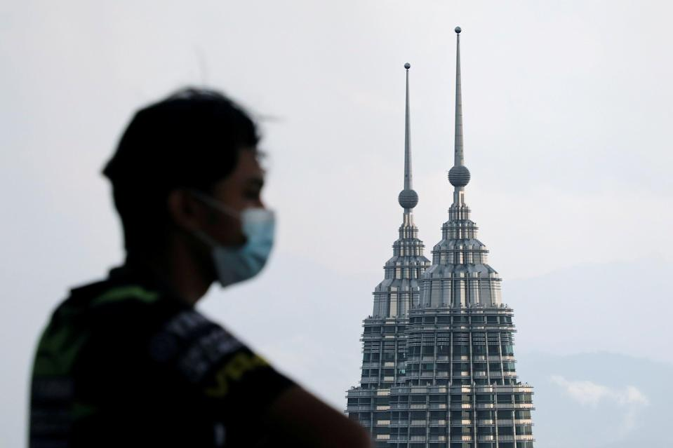 The aircraft was carrying two monks and military personnel for a ceremony to lay the foundations for a new monastery (pictured: Petronas Twin Towers in Kuala Lumpur) (REUTERS)
