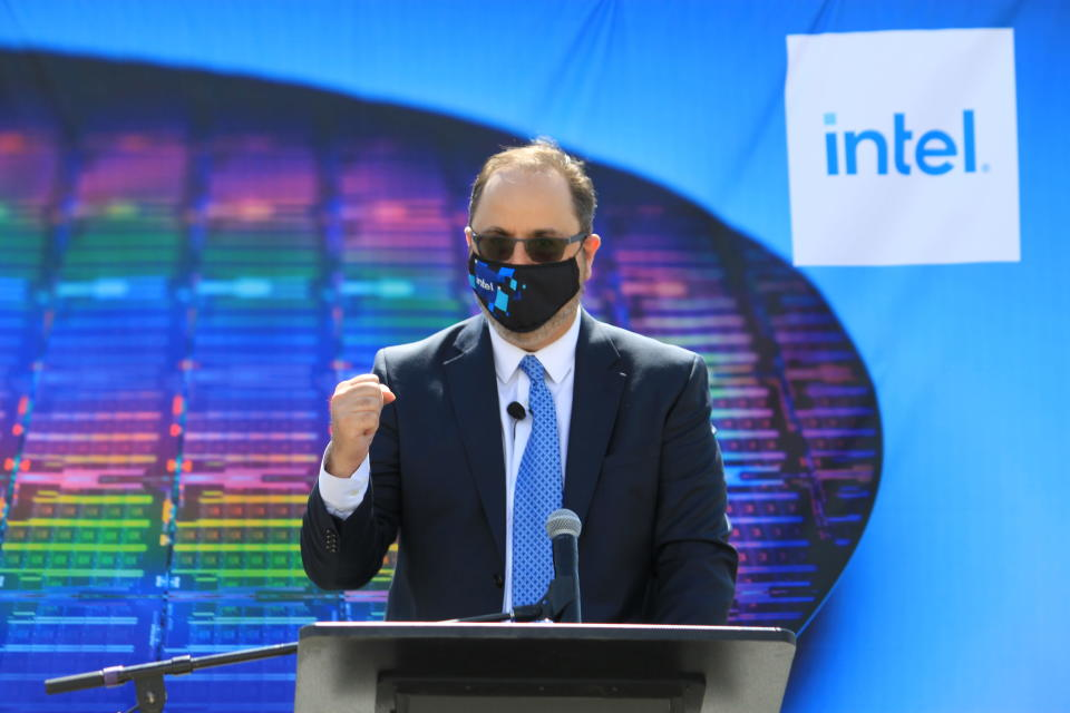 Intel Senior Vice President for Manufacturing and Operations Keyvan Esfarjani details plans to invest $3.5 billion in the company's New Mexico operations during a news conference Monday, May 3, 2021 in Rio Rancho, New Mexico. The company will modernize its Rio Rancho plant so can begin producing an advanced packaging system that will allow for better performance and capabilities. (AP Photo/Susan Montoya Bryan)