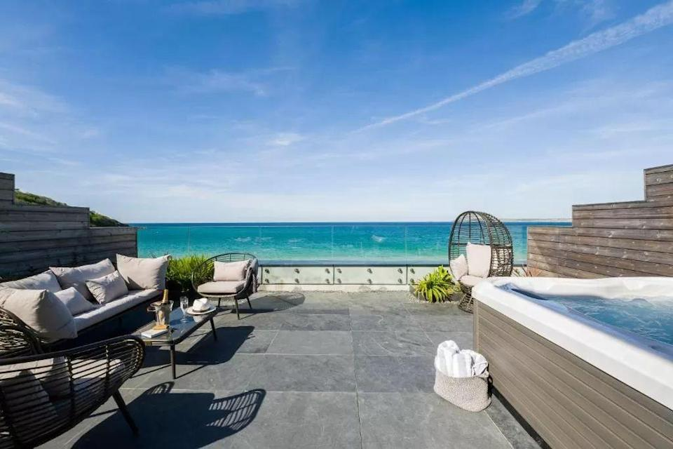 """<p>Checking into a beach hotel in the UK is a must during the summer months but a trip to the seaside can be just as lovely in autumn.</p><p>Our pick of the UK's best beach hotels are perfect for enjoying the last of this year's mild weather by the sea, complete with breezy coastal walks and your toes sinking into the sand.</p><p>In Cornwall, some of the wide expanses of golden sand are so beautiful they could rival any Mediterranean holiday. Take family-friendly <a href=""""https://go.redirectingat.com?id=127X1599956&url=https%3A%2F%2Fwww.booking.com%2Fhotel%2Fgb%2Fcarbis-bay-hotel.en-gb.html%3Faid%3D1922306%26label%3Dbeach-hotels-uk-intro&sref=https%3A%2F%2Fwww.goodhousekeeping.com%2Fuk%2Flifestyle%2Ftravel%2Fg34584524%2Fbeach-hotels-uk%2F"""" rel=""""nofollow noopener"""" target=""""_blank"""" data-ylk=""""slk:Carbis Bay"""" class=""""link rapid-noclick-resp"""">Carbis Bay</a> near St Ives, which sits on a privately-owned stretch of stunning Blue Flag beach. Near Padstow, upscale adults' eco-retreat <a href=""""https://go.redirectingat.com?id=127X1599956&url=https%3A%2F%2Fwww.booking.com%2Fhotel%2Fgb%2Fthe-scarlet.en-gb.html%3Faid%3D1922306%26label%3Dbeach-hotels-uk-intro&sref=https%3A%2F%2Fwww.goodhousekeeping.com%2Fuk%2Flifestyle%2Ftravel%2Fg34584524%2Fbeach-hotels-uk%2F"""" rel=""""nofollow noopener"""" target=""""_blank"""" data-ylk=""""slk:The Scarlet Hotel"""" class=""""link rapid-noclick-resp"""">The Scarlet Hotel</a> sits on a cliff overlooking the pristine sands of Mawgan Porth, while another cliffside hotel, <a href=""""https://go.redirectingat.com?id=127X1599956&url=https%3A%2F%2Fwww.booking.com%2Fhotel%2Fgb%2Fthe-headland.en-gb.html%3Faid%3D1922306%26label%3Dbeach-hotels-uk-intro&sref=https%3A%2F%2Fwww.goodhousekeeping.com%2Fuk%2Flifestyle%2Ftravel%2Fg34584524%2Fbeach-hotels-uk%2F"""" rel=""""nofollow noopener"""" target=""""_blank"""" data-ylk=""""slk:The Headland"""" class=""""link rapid-noclick-resp"""">The Headland</a>, has a prime position over Fistral Beach - ideal for dogs, families, solo travellers and couples alike.</p><p>Over in """