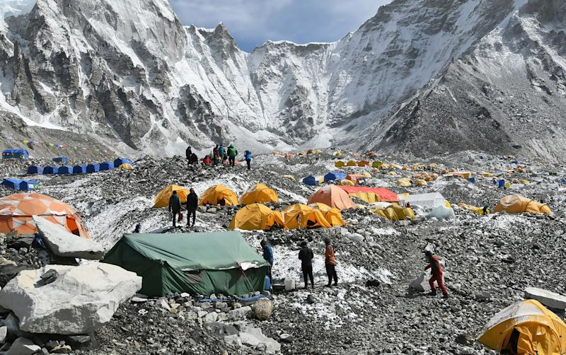 Trekkers and porters gather at Everest Base Camp on April 25, 2018. Hundreds of climbers cleared to scale Everest were acclimating there, officials said, including a record number of Nepali women climbers.