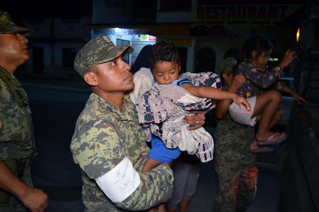 <p>Soldiers help children to get on a truck as residents are being evacuated from their coastal town after an earthquake struck off the southern coast, in Puerto Madero, Mexico, Sept. 8, 2017. (Photo: Jose Torres/Reuters) </p>