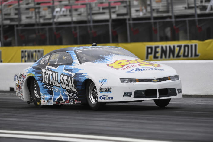 In this photo provided by the NHRA, Pro Stock driver Matt Hartford coasts to his second victory at the Mopar Express Lane NHRA SpringNationals at Houston Raceway Park in Baytown, Texas, when he defeated Deric Kramer in the final round Monday, May 24, 2021. (Gary Nastase/Auto Imagery via AP)