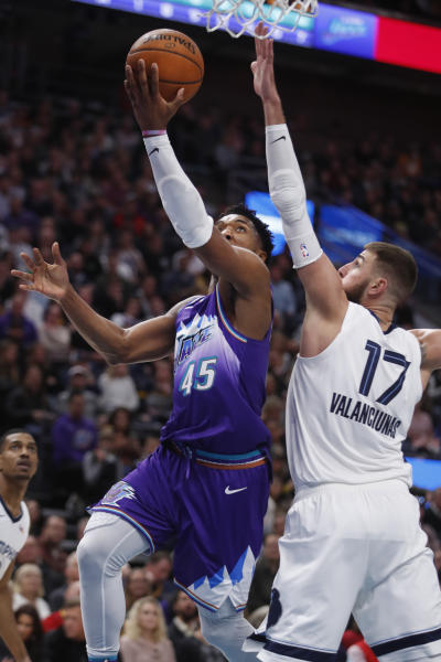 Utah Jazz guard Donovan Mitchell (45) lays the ball in past Memphis Grizzlies center Jonas Valanciunas (17) during the first half of an NBA basketball gam Saturday, Dec. 7, 2019, in Salt Lake City. (AP Photo/George Frey)