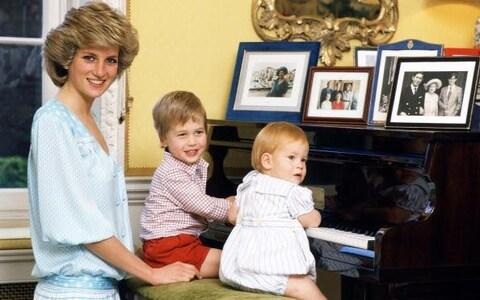 Diana, Princess of Wales with her sons, Prince William and P Original description: UNITED KINGDOM - OCTOBER 04: Diana, Princess of Wales with her sons, Prince William and Prince Harry, at the piano in Kensington Palace (Photo by Tim Graham/Getty Images) - Credit: Getty