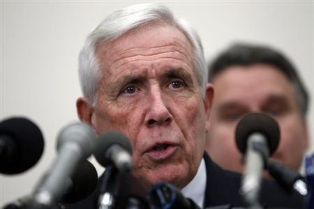 U.S. Representative Frank Wolf (R-VA) speaks with Rep. Chris Smith (R-NJ) (obscured) during a news conference on Capitol Hill in Washington