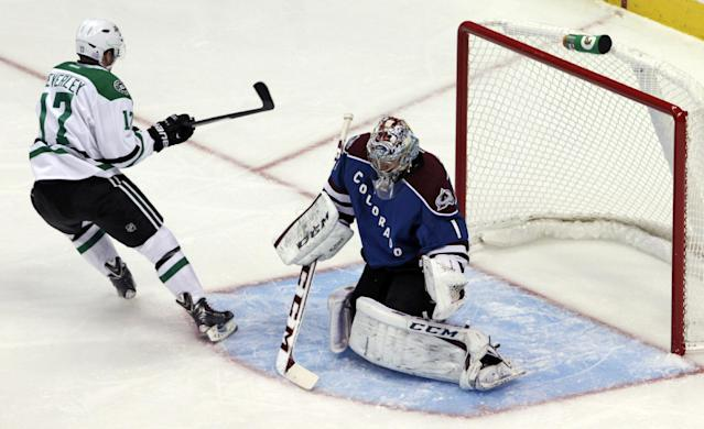 Dallas Stars center Rich Peverley (17) scores against Colorado Avalanche goalie Semyon Varlamov (1), of Russia, in the first period of an NHL hockey game in Denver on Tuesday, Oct. 15, 2013. (AP Photo/Joe Mahoney)
