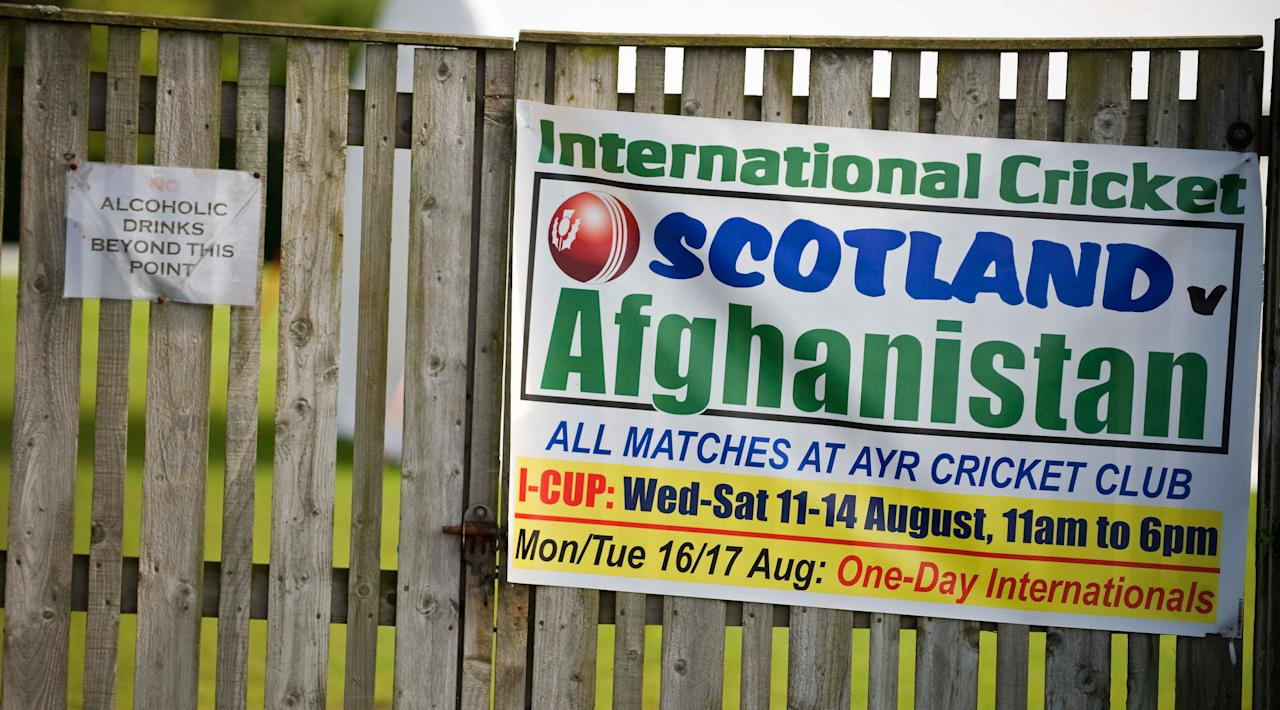 A poster promoting the ICC Intercontinental Cup clash between Scotland and Afghanistan, hangs on a gate in Ayr, Scotland on August 12, 2010.      AFP PHOTO/Derek Blair (Photo credit should read Derek Blair/AFP/Getty Images)