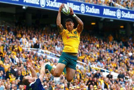 FILE PHOTO: Rugby Union - Australia vs Scotland - Sydney Football Stadium, Sydney, Australia - June 17, 2017 - Australia's Israel Folau jumps to catch the ball and score a try above Scotland's Greig Tonks. REUTERS/David Gray