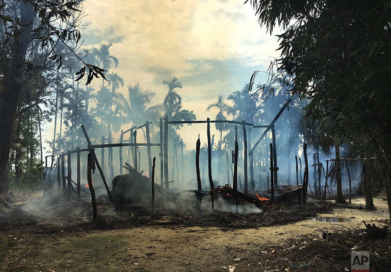 <p>Smoke rises from a burned house in Gawdu Zara village, northern Rakhine state, Myanmar. Journalists saw new fires burning Thursday in the Myanmar village that had been abandoned by Rohingya Muslims, and where pages from the Quran were seen ripped and left on the ground. (AP) </p>