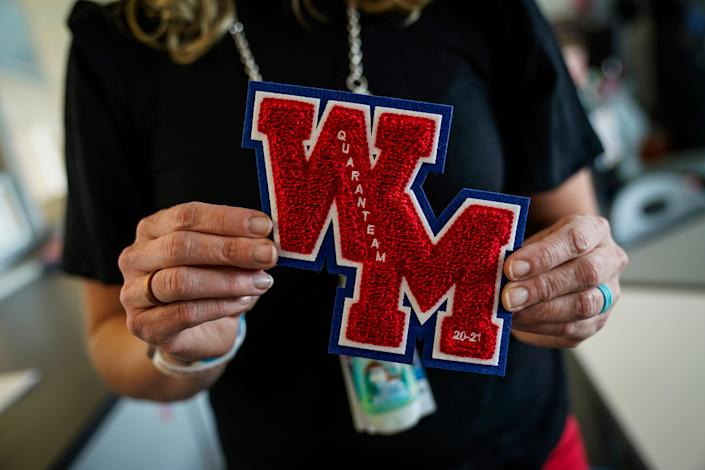 Stephanie Davy holds a specially designed West Mesa varsity letter patch, to recognize the strange 2020 year for student-athletes.