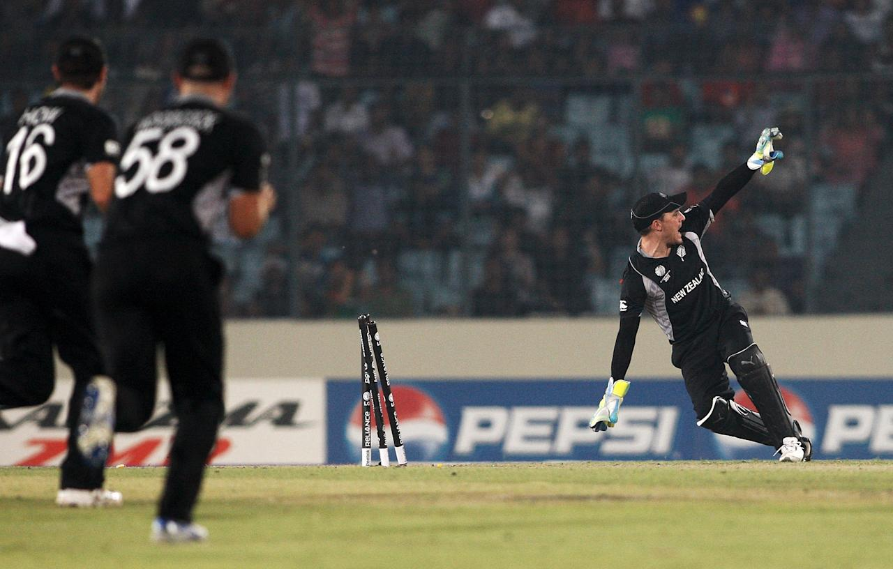 DHAKA, BANGLADESH - MARCH 25:   Brendon McCullum of New Zealand appeals for the run out of A.B de Villiers of South Africa  during 2011 ICC World Cup Quarter-Final match between New Zealand and South Africa at Shere-e-Bangla National Stadium on March 25, 2011 in Dhaka, Bangladesh.  (Photo by Graham Crouch/Getty Images)