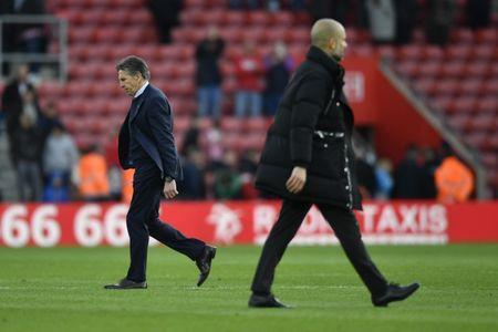 Britain Soccer Football - Southampton v Manchester City - Premier League - St Mary's Stadium - 15/4/17 Southampton manager Claude Puel after the match with Manchester City manager Pep Guardiola Action Images via Reuters / Tony O'Brien Livepic