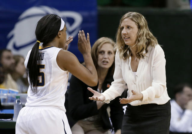 California's Brittany Boyd (15) celebrates with coach Lindsay Gottlieb late in the second half of a first-round game in the NCAA women's college basketball tournament against Fordham, Saturday, March 22, 2014, in Waco, Texas. California won 64-63. (AP Photo/Tony Gutierrez)
