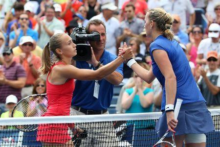 Aug 30, 2014; New York, NY, USA; Aleksandra Krunic (SRB) is congratulated by Petra Kvitova (CZE) after defeating her at Armstrong Stadium on day six of the 2014 U.S. Open tennis tournament at USTA Billie Jean King National Tennis Center. Anthony Gruppuso-USA TODAY Sports