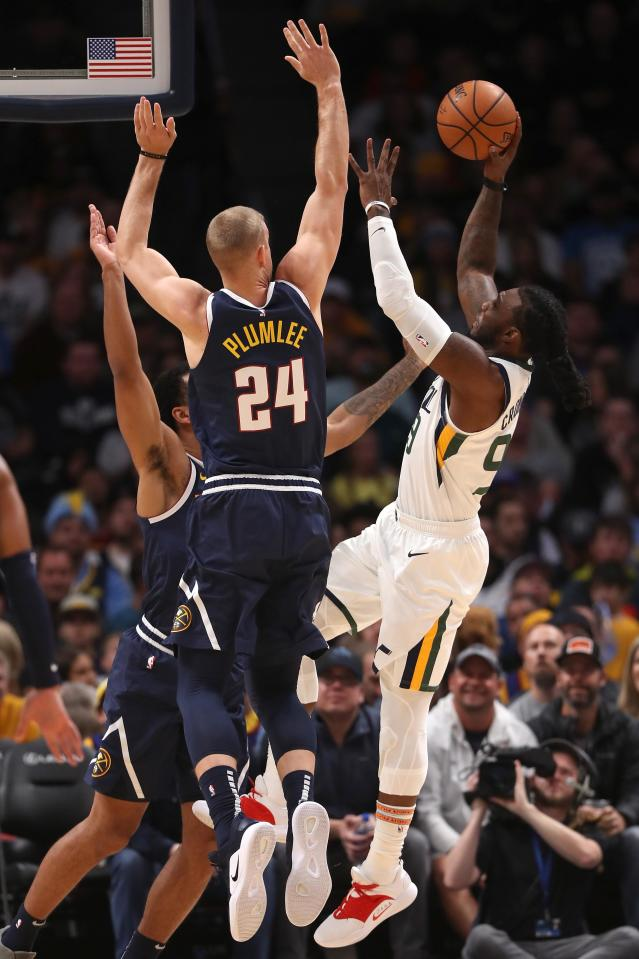 DENVER, CO - NOVEMBER 03: Jae Crowder #99 of the Utah Jazz puts up a shot against Trey Lykes #7 and Mason Plumlee #24 of the Denver Nuggets in the first quarter at the Pepsi Center on November 3, 2018 in Denver, Colorado. (Photo by Matthew Stockman/Getty Images)