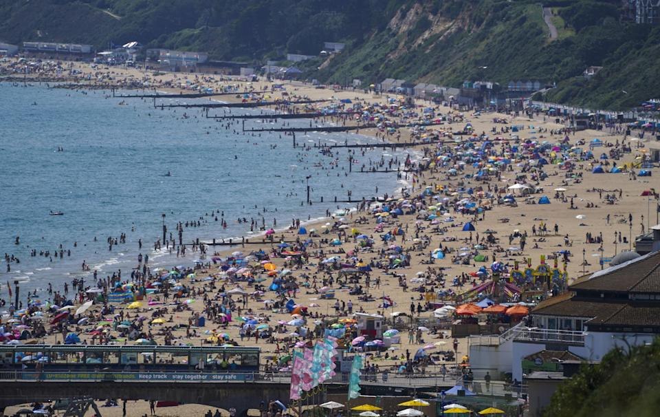 People enjoy the weather on Bournemouth beach (Steve Parsons/PA) (PA Wire)