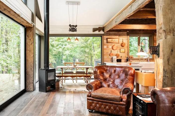 """<p><strong>Goodlettsville, Tennessee</strong></p> <p>You'll find this cozy gem right outside of Nashville, so you can pop in and out of Music City and retreat to the wilderness when your sightseeing is complete. The living room of this newly constructed <a href=""""https://www.architecturaldigest.com/gallery/best-cabins-to-bookmark-on-airbnb?mbid=synd_yahoo_rss"""" rel=""""nofollow noopener"""" target=""""_blank"""" data-ylk=""""slk:cabin"""" class=""""link rapid-noclick-resp"""">cabin</a> made from reclaimed materials has a TV and sound system for listening to tunes, and you can retire to one of two bedrooms for views of the forest while resting. The indoor fireplace is the perfect spot for chilly evenings.</p> $189, Airbnb. <a href=""""https://www.airbnb.com/rooms/plus/11074483"""" rel=""""nofollow noopener"""" target=""""_blank"""" data-ylk=""""slk:Get it now!"""" class=""""link rapid-noclick-resp"""">Get it now!</a>"""