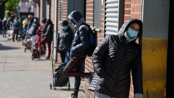 PHOTO: Recipients of the nonprofit organization The River Fund wait in line to receive free groceries on May 9, 2020, in Queens, New York. (Bryan Thomas/Getty Images)