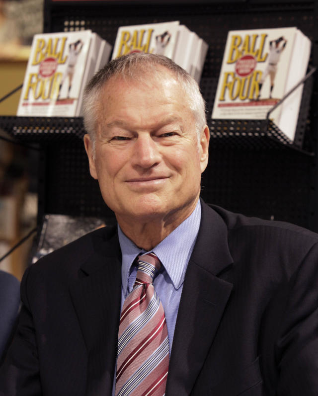 """Former New York Yankees pitcher Jim Bouton signs copies of the Associated Press book """"New York Yankees 365,"""" in New York, Wednesday, Oct. 7, 2009. (AP Photo/Richard Drew)"""