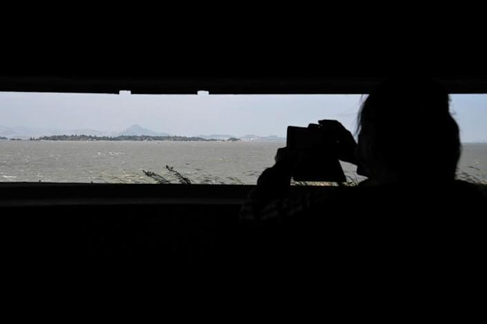 A tourist takes a photo from the Mashan Observation Post on Kinmen island