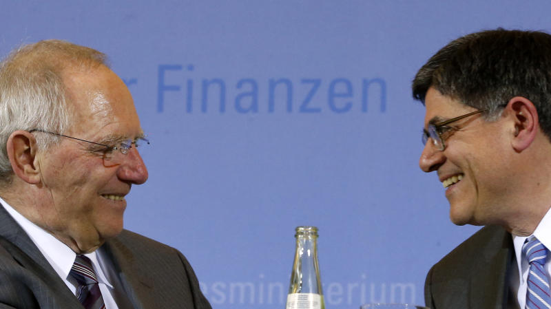 German Finance Minister Wolfgang Schaeuble, left, and his U.S. counterpart Jacob J. Lew, right, smile after a press conference as part of a meeting at the finance ministry in Berlin, Germany, Tuesday, April 9, 2013. (AP Photo/Michael Sohn)