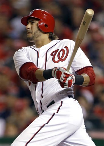 Washington Nationals' Michael Morse watches his two-run home run in the third inning of Game 5 of the National League division baseball seriesagainst the St. Louis Cardinals on Friday, Oct. 12, 2012, in Washington. (AP Photo/Pablo Martinez Monsivais)