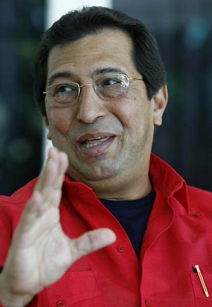 FILE - In this April 7, 2006 file photo, Adan Chavez, Venezuela's ambassador to Cuba and Hugo Chavez's older brother, smiles during an interview at his home in Havana, Cuba. Adan Chavez said Tuesday, Dec. 18, 2012 that widespread abstention in the recent elections for state governors hurt both the government party and the opposition, and said that some followers of President Hugo Chavez even voted for opposition candidates. Adan Chavez was re-elected as governor of Barinas state. (AP Photo/Javier Galeano, File)