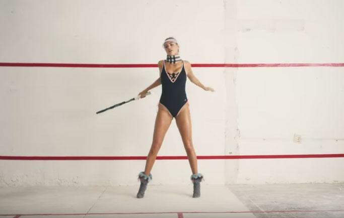 Kate swaps the catwalk for the tennis court, stripping down to a sleek black leotard that leaves little to the imagination. Source: Love/Phil Poynter