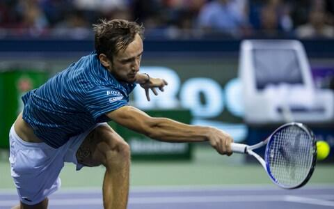 <span>Daniil Medvedev of Russia hits a forehand against Stefanos Tsitsipas</span> <span>Credit: Getty Images AsiaPac </span>
