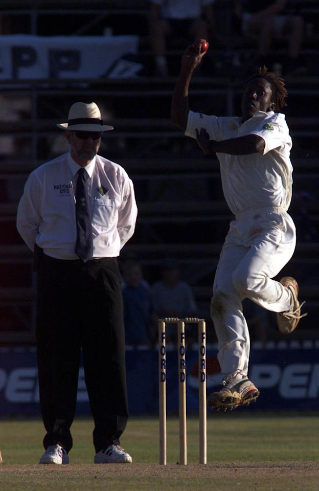 15 Oct 1999:   Henry Olonga of Zimbabwe bowling with umpire Ian Robinson looking on, during day two of the one off test match between Zimbabwe and Australia at Harare Sports Club, Harare, Zimbabwe.X  Mandatory Credit: Hamish Blair/ALLSPORT