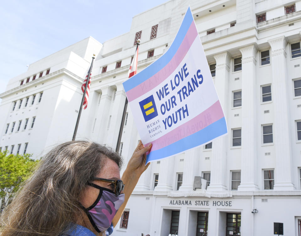 A protestor at the Alabama State House recently drew attention to anti-transgender legislation introduced in that state. (Photo by Julie Bennett/Getty Images)