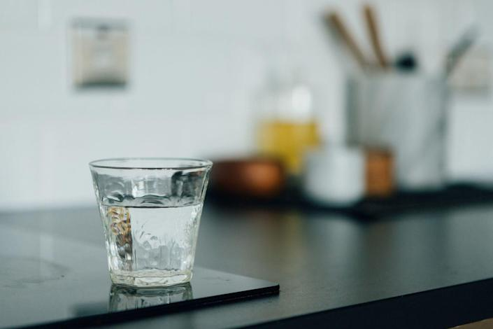 """<p>Drinking glasses looking grimy? According to <em>Martha Stewart</em>, <a href=""""https://www.marthastewart.com/273273/cleaning-cloudy-glasses"""" rel=""""nofollow noopener"""" target=""""_blank"""" data-ylk=""""slk:cloudy drinking glasses can be cleaned up with vinegar"""" class=""""link rapid-noclick-resp"""">cloudy drinking glasses can be cleaned up with vinegar</a>. Soak a small dish towel or rag in a small amount of white vinegar and wipe the glass with the cloth. You can also remove the buildup caused by calcium and magnesium ions in hard water by swabbing the glass with acetone (nail polish remover), and then scrubbing gently with a mild detergent. </p><p>Soaking your dingy drinking glasses in white distilled vinegar for 15 minutes is another effective solution. </p>"""