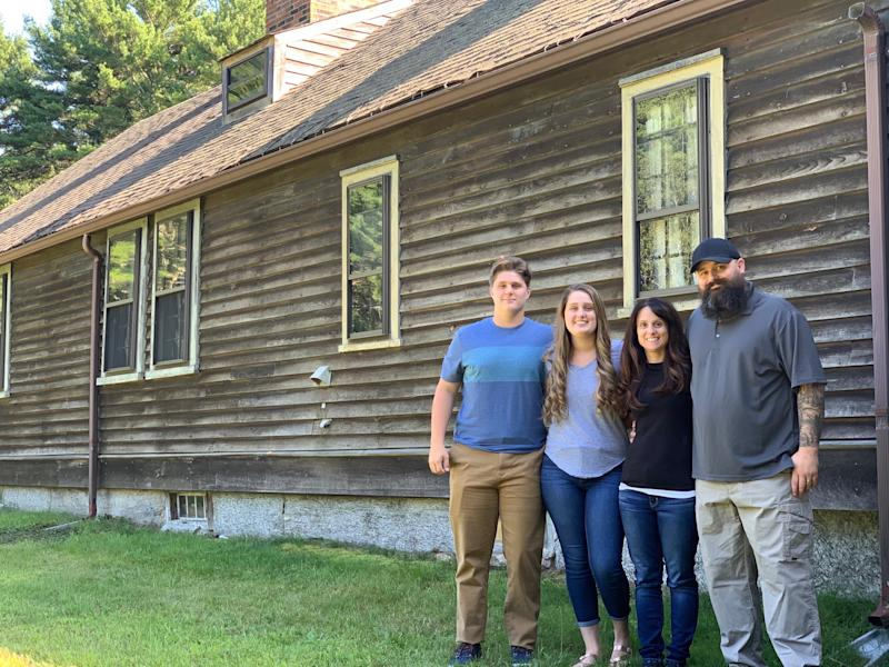 "Cory Heinzen and his wife Jennifer, pictured with their son Kyler and daughter Madison, bought the haunted home that inspired ""The Conjuring."" (Photo: Katie Heinzen)"
