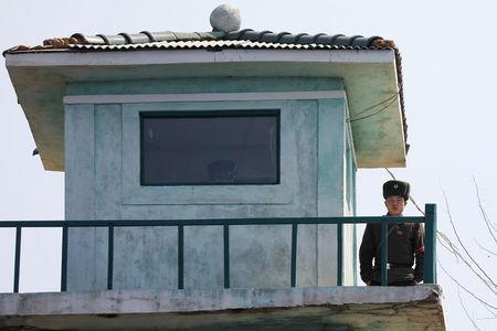 A North Korean soldier looks from a watchtower on the banks of the Yalu River, just north of Sinuiju, North Korea, March 31, 2017. REUTERS/Damir Sagolj