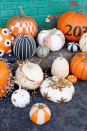"""<p>If you want to make the pumpkins your focal point but want more than plain orange gourds on your porch, consider getting hands-on with paint. You can even use a bigger pumpkin to showcase your house number, making it easier for guests and delivery people to spot your residence. </p><p><strong>See more at <a href=""""https://abeautifulmess.com/easy-no-carve-pumpkin-ideas/"""" rel=""""nofollow noopener"""" target=""""_blank"""" data-ylk=""""slk:A Beautiful Mess"""" class=""""link rapid-noclick-resp"""">A Beautiful Mess</a>. </strong></p><p><a class=""""link rapid-noclick-resp"""" href=""""https://www.amazon.com/Apple-Barrel-Acrylic-Assorted-Colors/dp/B0012JQD5Y?tag=syn-yahoo-20&ascsubtag=%5Bartid%7C2164.g.36877187%5Bsrc%7Cyahoo-us"""" rel=""""nofollow noopener"""" target=""""_blank"""" data-ylk=""""slk:SHOP BLACK PAINT"""">SHOP BLACK PAINT</a></p>"""
