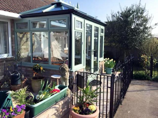 <p>The entrance of the home is bright and airy and features lots of local plant life.<br>(Airbnb) </p>