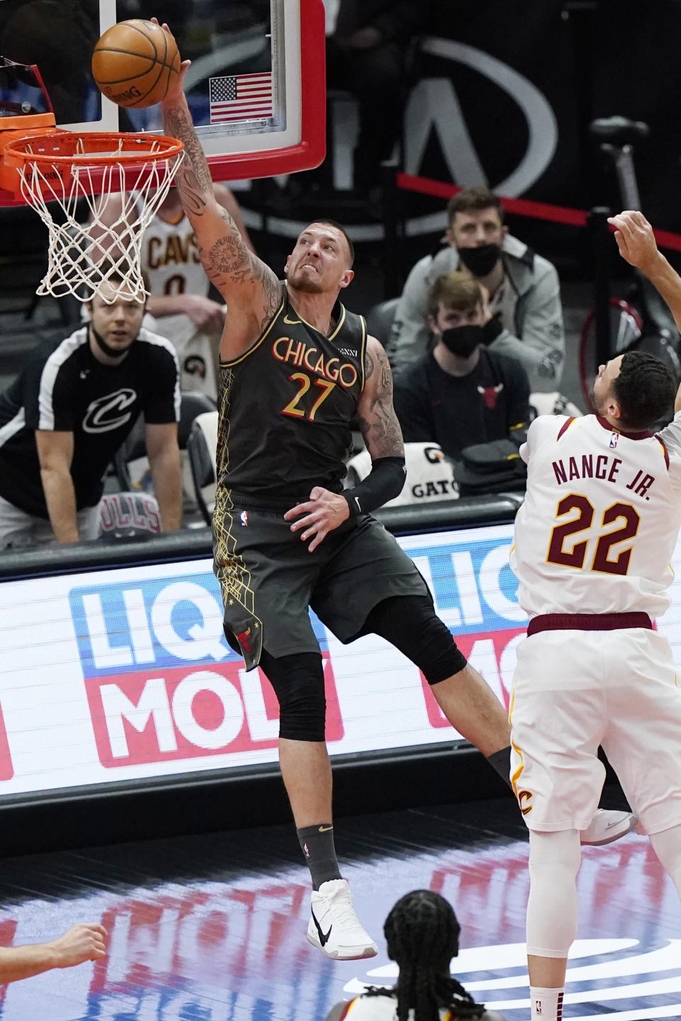Chicago Bulls center Daniel Theis dunks against Cleveland Cavaliers forward Larry Nance Jr. during the second half of an NBA basketball game in Chicago, Saturday, April 17, 2021. (AP Photo/Nam Y. Huh)